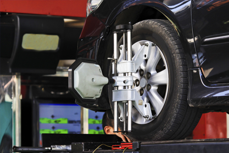 Coupon for Computer Alignment Get Your Car Going Straight From all the Potholes