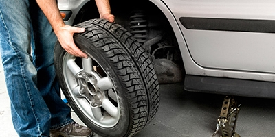 Coupon for 4 Wheel Alignment $59.95