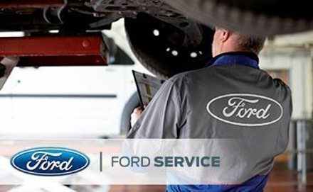Ford Service Technician Changing Tire