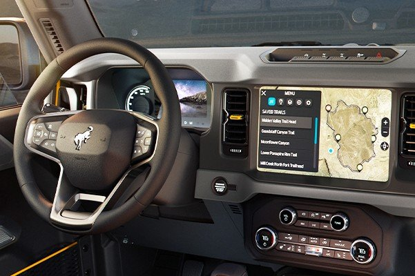 Interior of the 2021 Ford Bronco with mountain landscape through windows