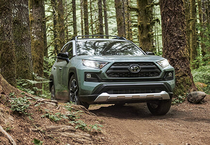 2019 toyota rav4 driving through the woods in dover nh