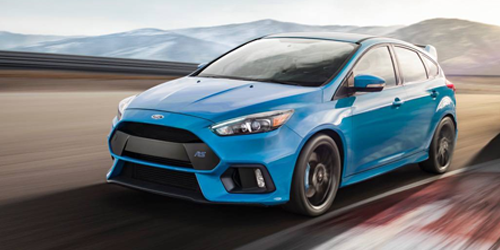 blue ford focus rs racing down the spaulding turnpike in NH