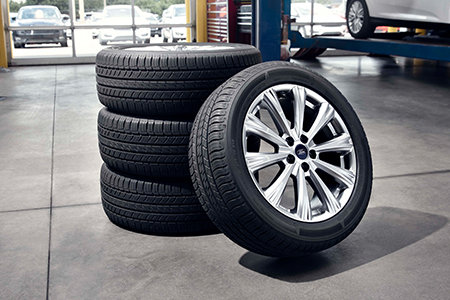 Coupon for Get up to a $70 rebate by mail when you buy four select tires Plus another $50 when you use the Ford Service Credit Card for your tire purchase*