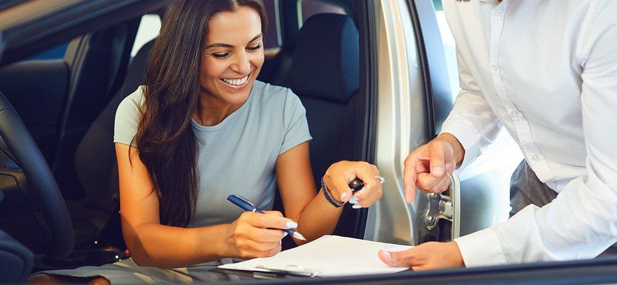 woman signing paperwork