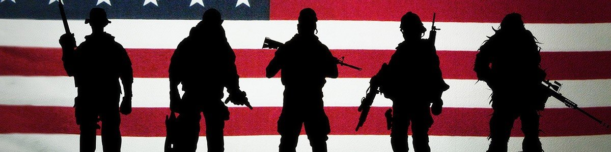 soldiers in front of the United States Flag