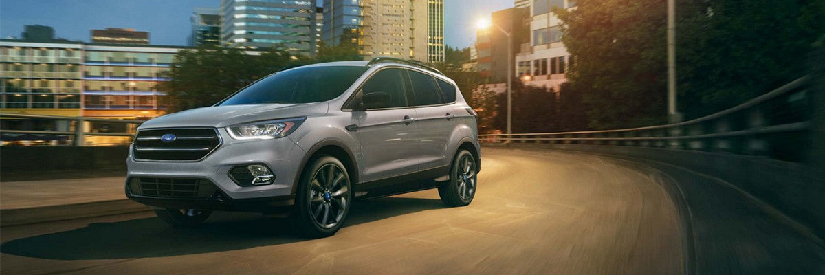 2018 Ford Escape driving on road at night