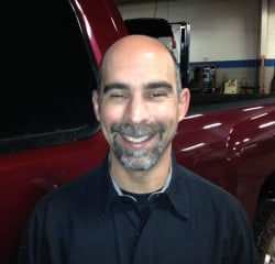 Technology and Production Manager Neil Miller in Service at Kightlinger Motors