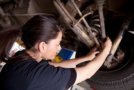 Mechanic at Westbury Toyota on Long Island, NY., working on the suspension of a vehicle.