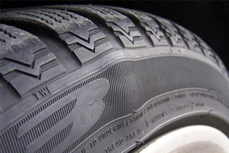 Tire bubble forming on Toyota in Westbury, NY.