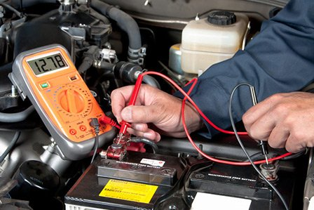 Checking a car's battery at Westbury Toyota on Long Island, NY.