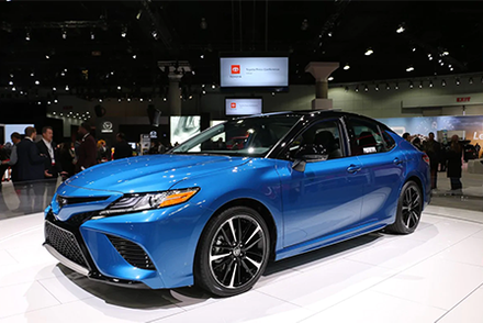 Blue 2020 Toyota Camry AWD on display at auto show.