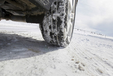 Snow tires on a wintry road here on Long Island, NY.