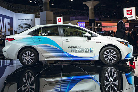2020 Toyota Corolla Hybrid on display at automotive trade show.