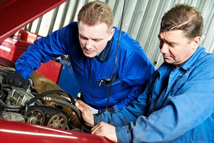 Two mechanics at Westbury Toyota on Long Island replacing a worn out timing belt.