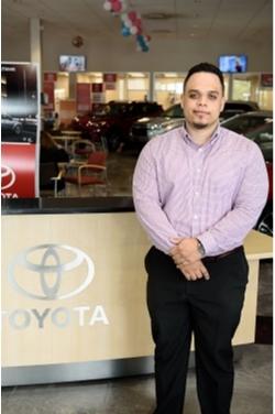 Service Advisor Jon Munoz in Service at Westbury Toyota