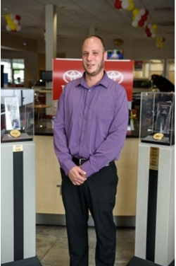 Service Director Justin Feuer in Service at Westbury Toyota