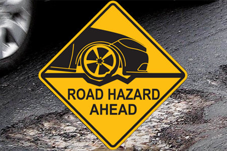 Coupon for 2-Year Road Hazard Protection Free with most tires