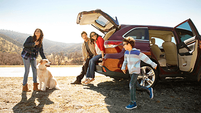Family getting out of their Toyota RAv4