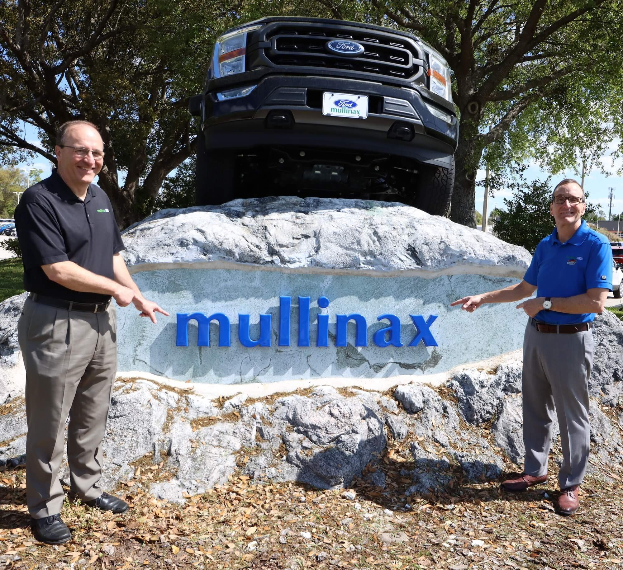 Mullinax Ford - Larry and Jerry with F-150 on Rock