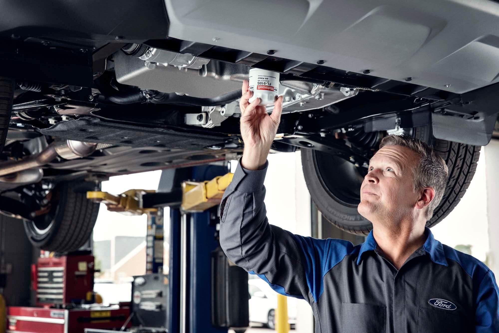 Quick Lane - Service Technician Replacing Oil Filter