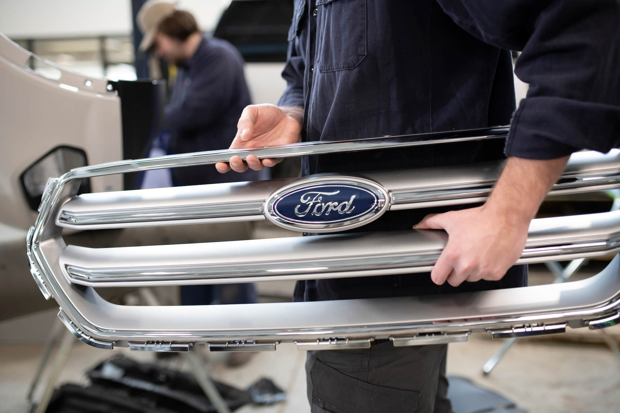 Mullinax Ford - Body Shop Technician Carring Grill