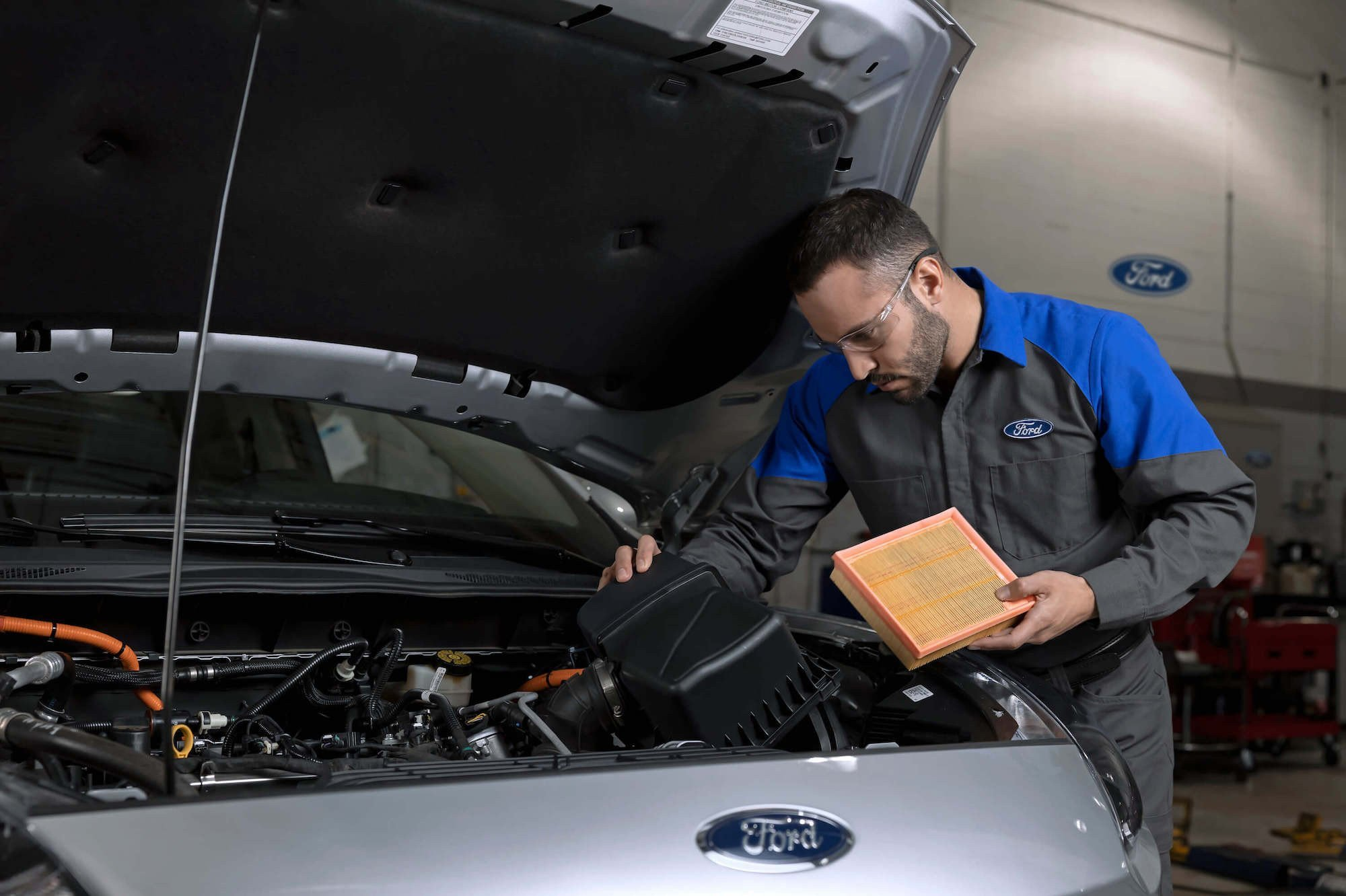 Mullinax Ford - Service Technician Replacing Air Filter
