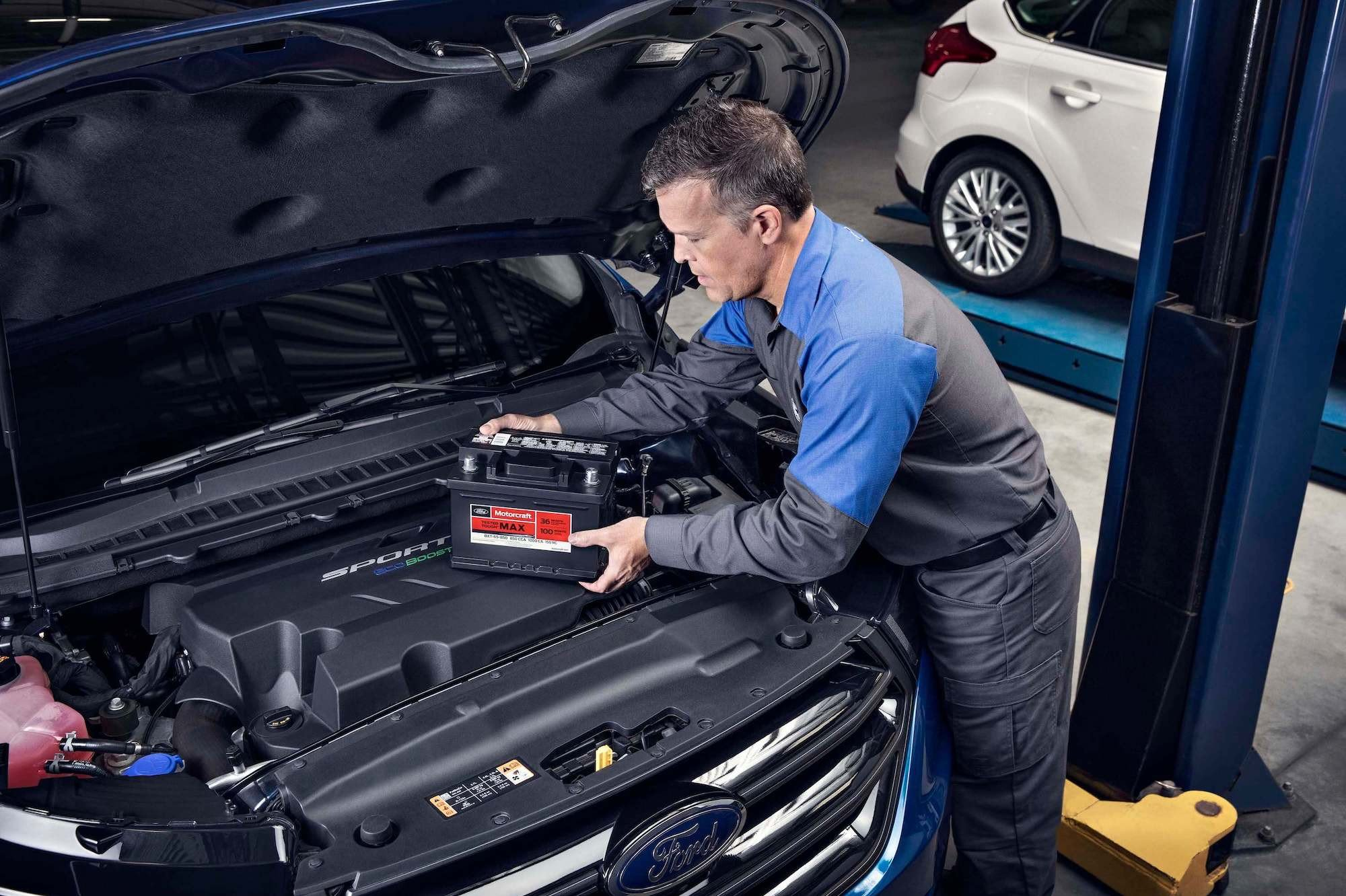 Quick Lane - Service Technician Changing Battery