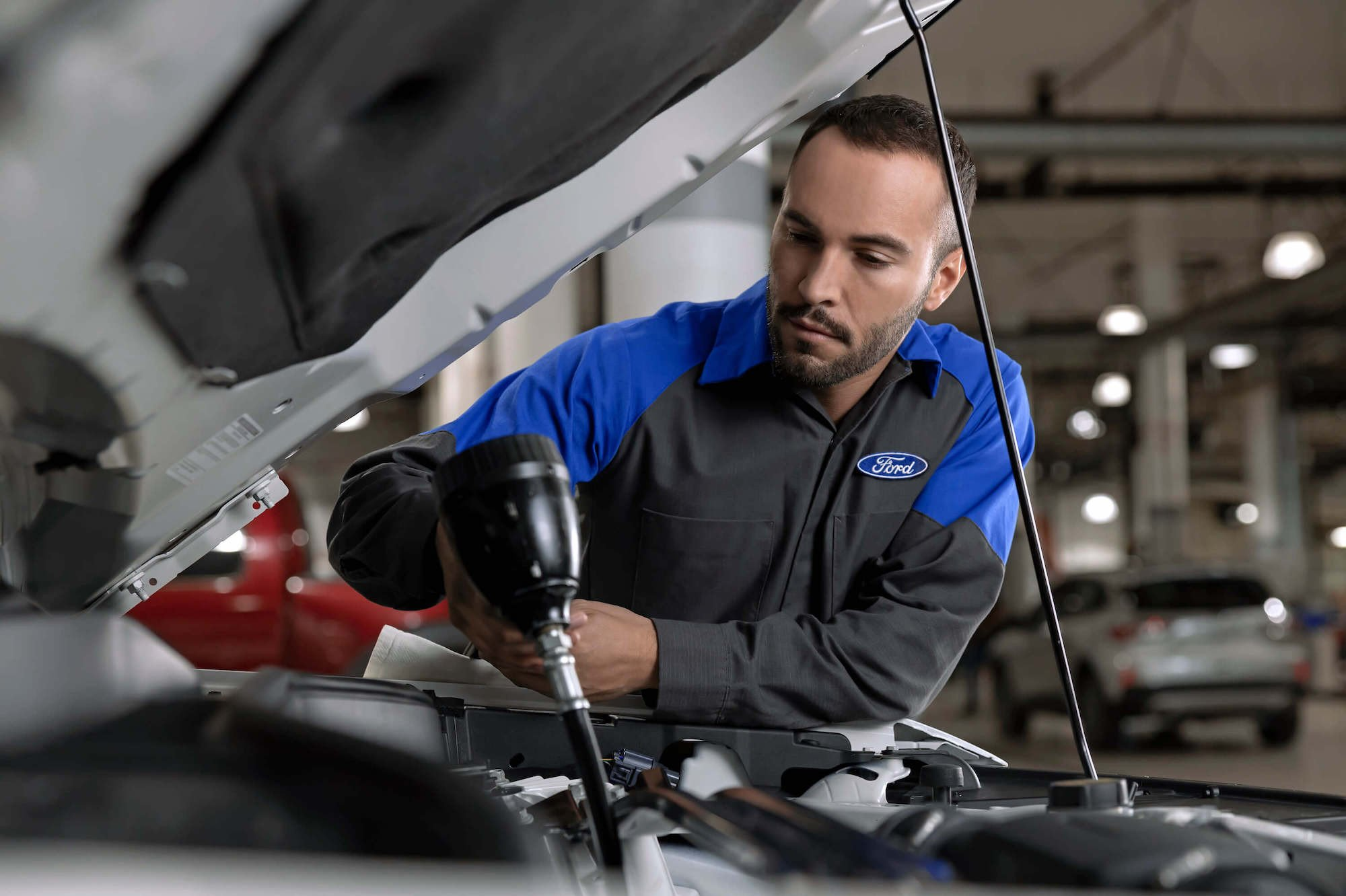 Quick Lane - Service Technician Changing Oil