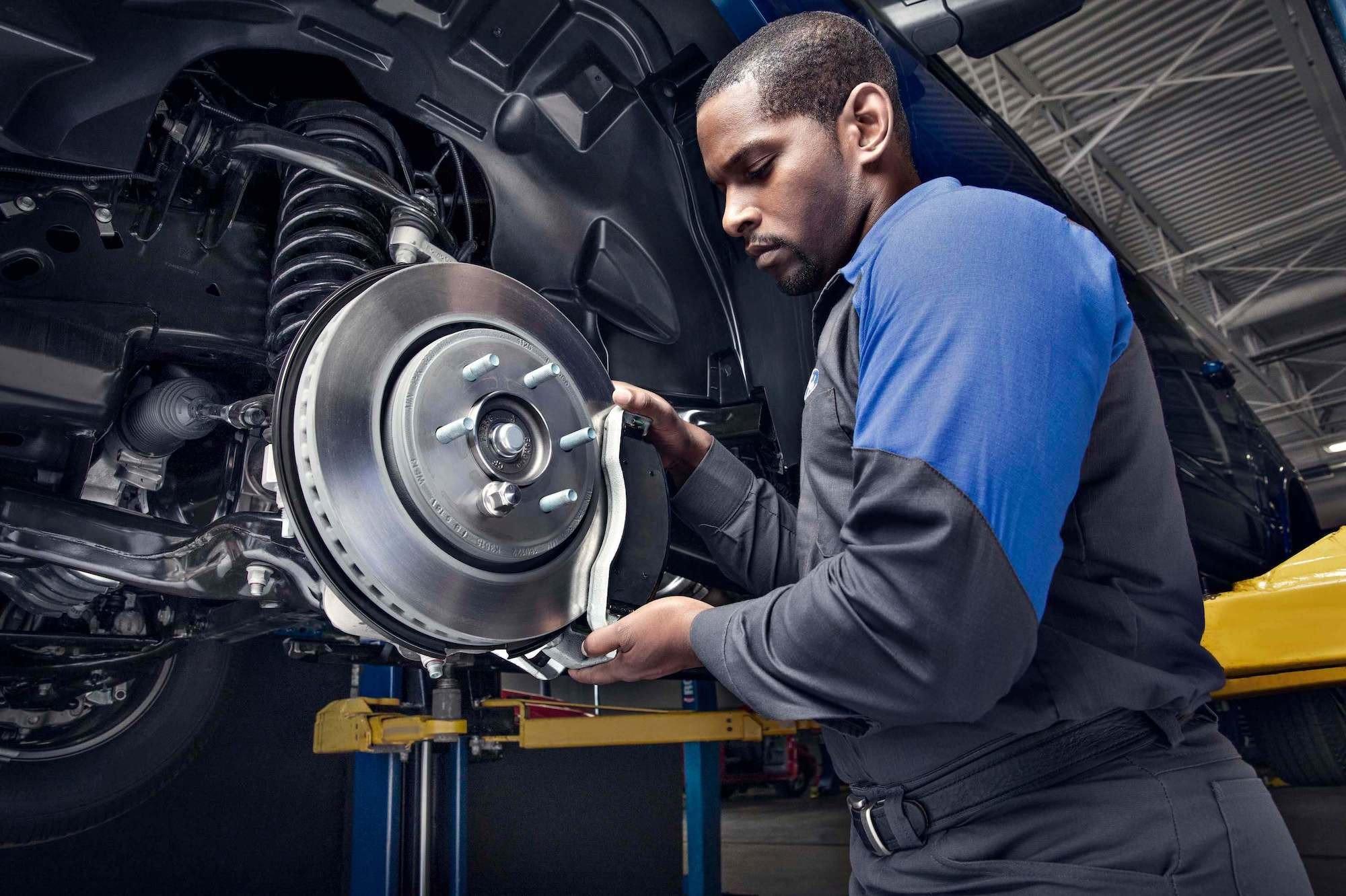 Quick Lane - Service Technician Changing Brakes
