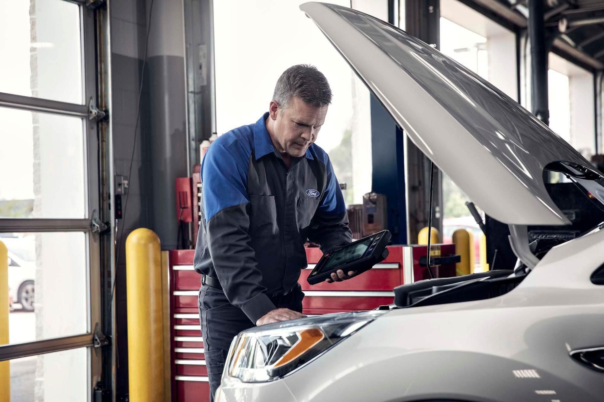 Mullinax Ford - Service Technician Running Vehicle Diagnostic