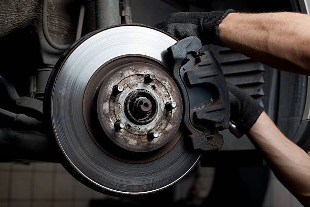 Brake job being conducted by mechanic at Westbury Toyota on Long Island, NY.