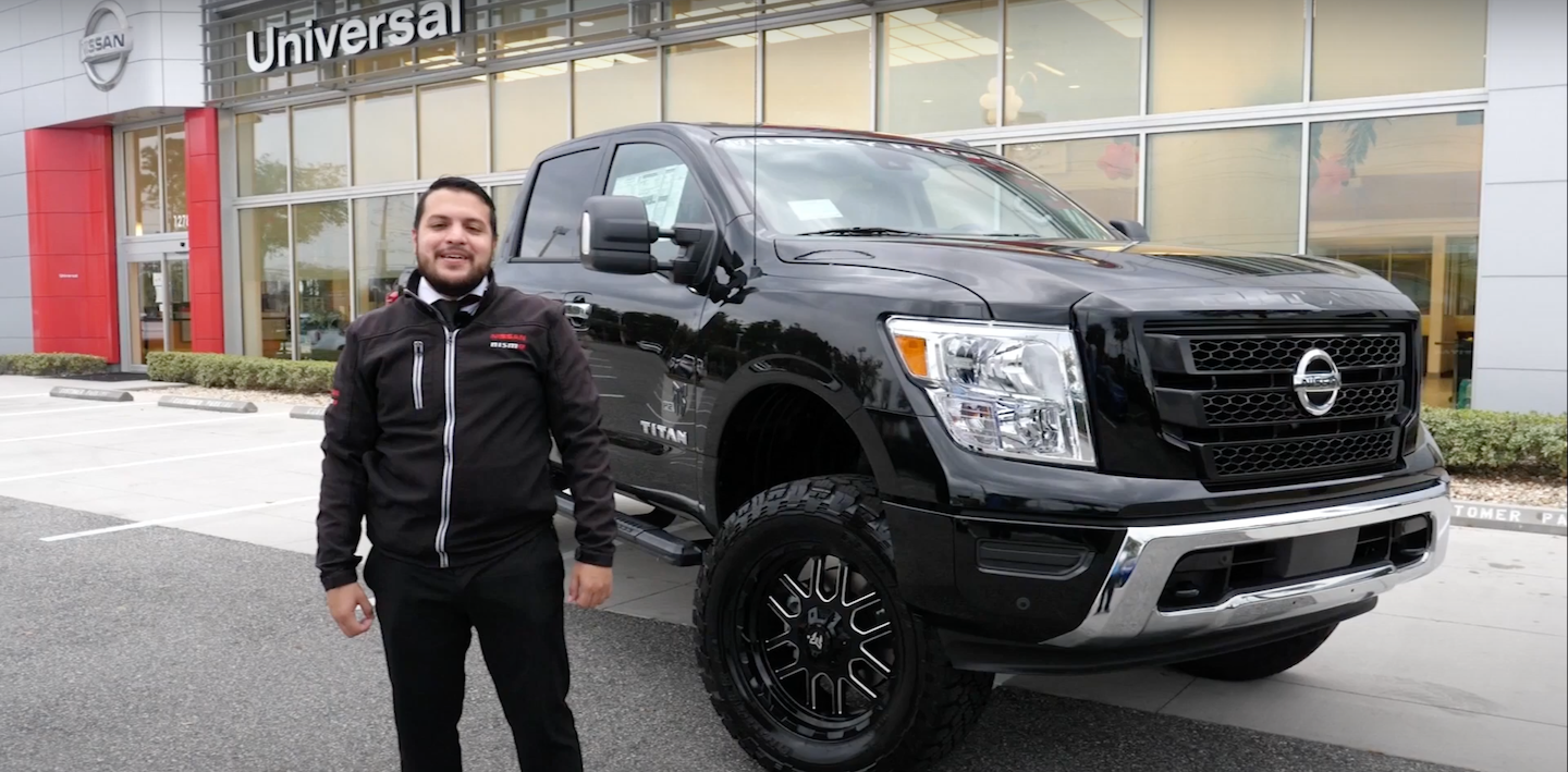 Seth Lugo of Universal Nissan next to the 2021 Nissan Titan Rocky Ridge.