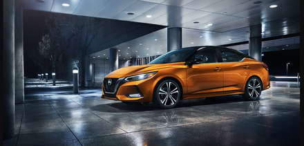 The 2021 Nissan Sentra parked outside at nighttime.