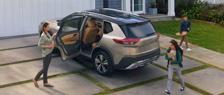 The 2021 Nissan Rogue parked as a family gets ready for their day.