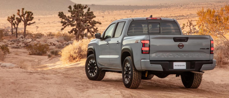2022 Nissan Frontier driving in a desert.