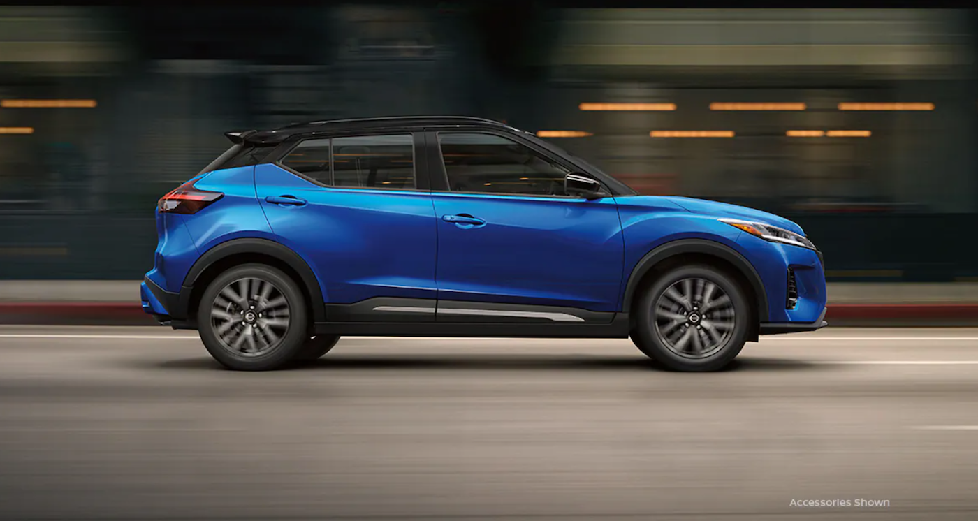 The 2021 Nissan Kicks driving on a highway.