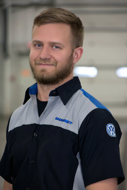 VW Technician Ryan Wishard in Service at Sharrett Auto Stores