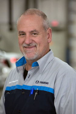 Mazda Technician Doug Myers in Service at Sharrett Auto Stores