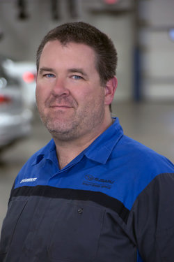 Subaru Technician Jake Moran in Service at Sharrett Auto Stores