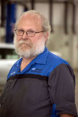 Subaru Technician Mark Reed in Service at Sharrett Auto Stores