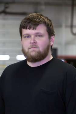 GM Quick Service Technician Nolan Myers in Service at Sharrett Auto Stores