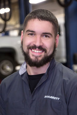 GM / Domestic Technician Tristan Clopper in Service at Sharrett Auto Stores