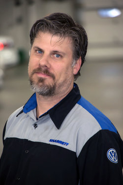 VW Technician Scott Bolling in Service at Sharrett Auto Stores