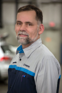 Mazda Technician Todd Ritz in Service at Sharrett Auto Stores