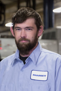 Detail Technician Ryan Exline in Service at Sharrett Auto Stores