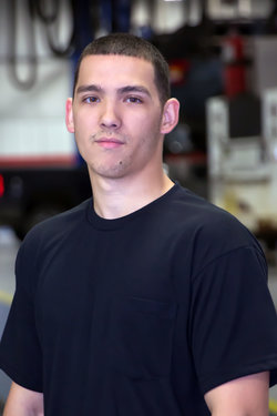 Detail Technician Logan Messenger in Service at Sharrett Auto Stores
