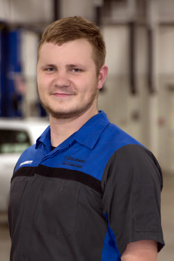 Quick Service Technician Seth Lantz in Service at Sharrett Auto Stores
