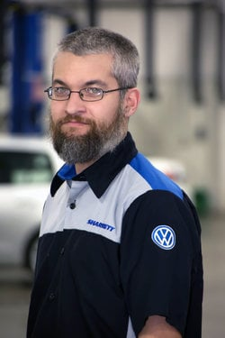 VW Technician Jason Lake in Service at Sharrett Auto Stores