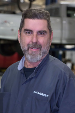 GM / Domestic Technician Mark Shaw in Service at Sharrett Auto Stores