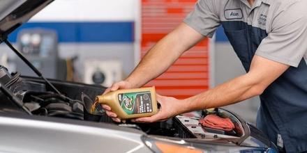 Hyundai Service Technician Performing Oil Change
